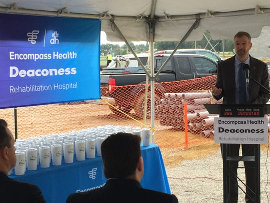 Deaconess Health System CEO Shawn McCoy speaks Wednesday at the construction site of Encompass Health Deaconess Rehabilitation Hospital, which is to open in October 2019.
