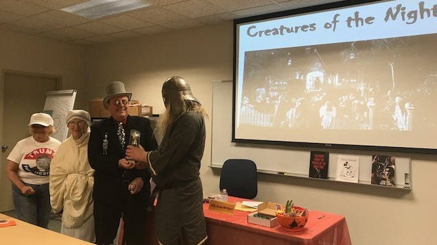 """Anyone can enter the """"Best Costume"""" contest held during the Fond du Lac Area Writers Halloween presentation """"Tales for the Dark Side of the Mind"""" starting at 7 p.m. Tuesday, Oct. 23. The winner will receive a """"Best Costume"""" trophy.  2018 Best Costume winner Josiah Zabel is presented with his trophy."""