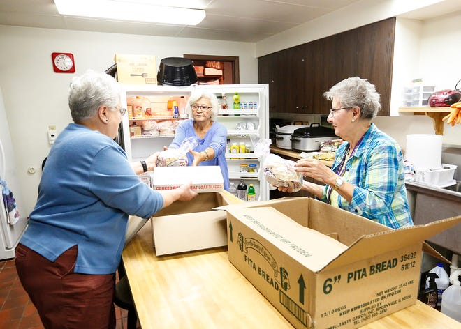 Dena Meyst, Presbytera Toula, and Peggy Kallas unload gyro meat and pita bread Wednesday, October 10, 2018 at the Greek Orthodox Church in Fond du Lac, Wisconsin as they prepare for the churches fundraiser selling gyros in the church parking lot Saturday, Oct. 13. Doug Raflik/USA TODAY NETWORK-Wisconsin