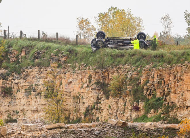 A Fond du Lac County Sheriff's Department official takes photos of a single vehicle crash that resulted in a fatality Wednesday, Oct. 10, 2018 near State Highway 41 near County Highway B. Doug Raflik/USA TODAY NETWORK-Wisconsin