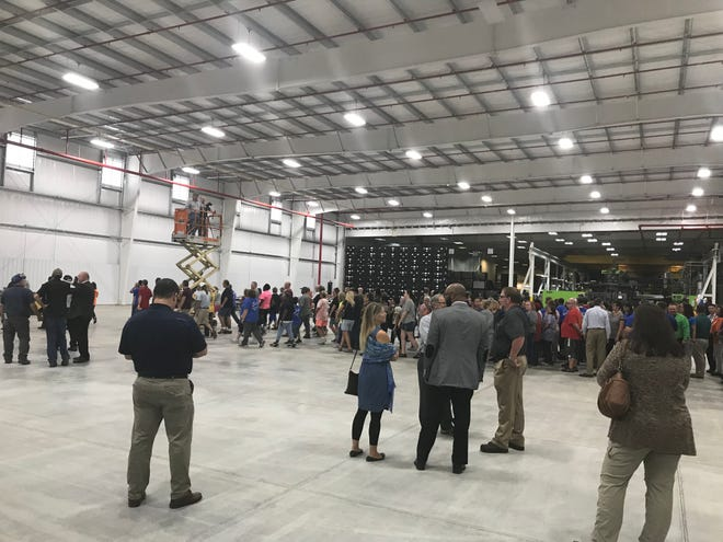 Auto supply company ABC Inoac celebrates the new 28,000-square-foot addition at its Fremont plant Wednesday. The company also announced it has been named a 2017 GM Supplier of the Year.