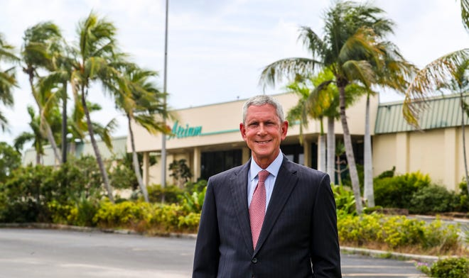 Joseph Catti, president & CEO of FineMark National Bank & Trust in front of The Atrium, a mixed-use office retail building. FineMark- A created limited liability corporation recently purchased the property. The plan is to raze the building, and construct a much-bigger headquarters for FineMark.