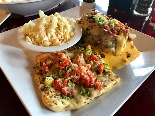 Yucatan's Key lime mahi came topped with tomatoes, green onions and Parmesan with a loaded baked potato and coleslaw chosen from the list of sides.