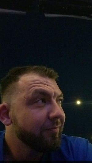 Scott Dingess takes selfie moments before hearing gunshots at Bell Tower Shops on Tuesday night.