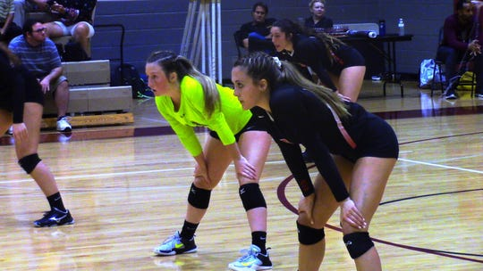 North Fort Myers' volleyball juniors Madi Barron (neon) and Katie Dickey are vital pieces to the puzzle for the Red Knights as Barron leads the team in digs and Dickey is one of the top attackers in Southwest Florida.