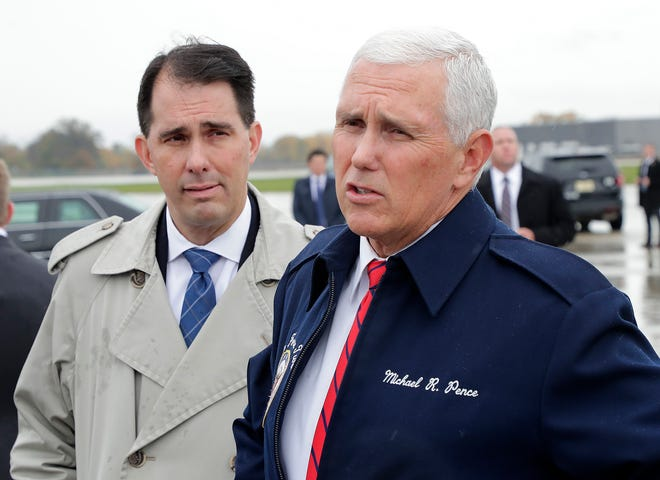 Vice President Mike Pence and Gov. Scott Walker arrive at Green Bay Austin Straubel International Airport on  Wednesday.