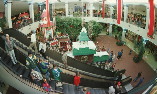 Shoppers make their way through the center court in Port Plaza Mall in 1998.