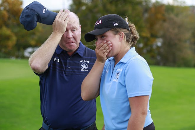 Bay Port's Jo Baranczyk, right, and her coach Jeff Johnsen get emotional while celebrating her victory with fans and family members on hole No. 4 at the WIAA Division 1 state girls golf tournament Tuesday at University Ridge Golf Course in Madison.
