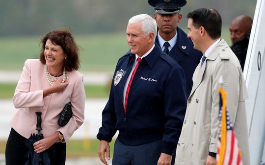 Vice President Mike Pence arrived at Green Bay Austin Straubel International Airport Wednesday afternoon with U.S. Senate candidate Leah Vukmir, left, and Gov. Scott Walker.
