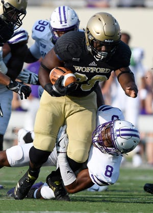 Wofford's Andre Stoddard (29) breaks the tackle of Furman's Bryan Okeh (8) during the teams' game Sept. 2, 2017. Stoddard, a former St. Joseph's Catholic School star, rushed for 64 yards and a touchdown in the game.