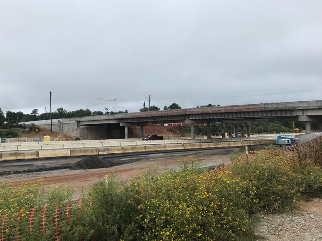 The Roper Mountain Road bridge over I-85 undergoes construction work. The old bridge is being replaced by a new, wider bridge.
