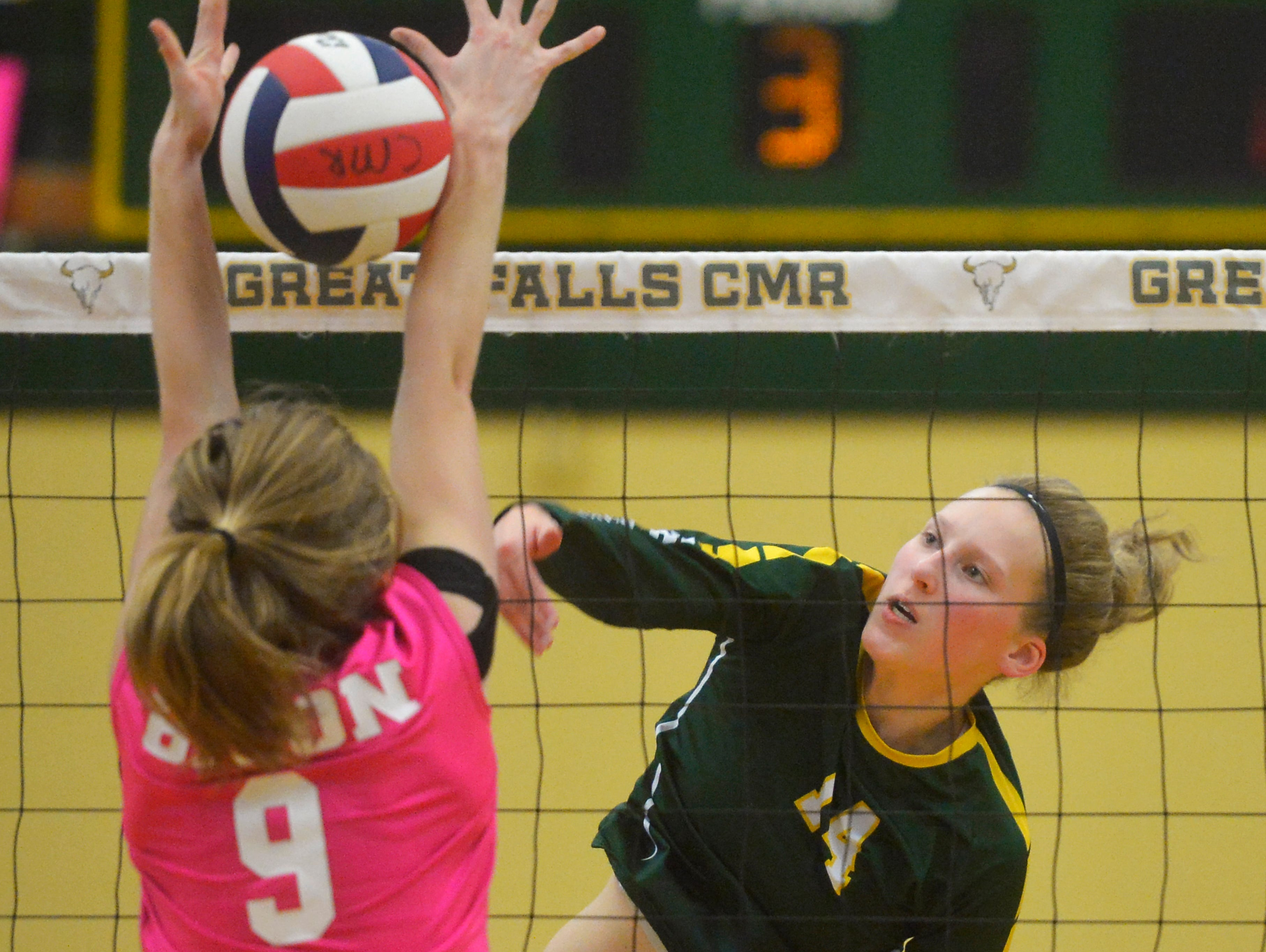 CMR's Allie Olsen spikes at the net during the crosstown volleyball match in the CMR Fieldhouse, Tuesday.