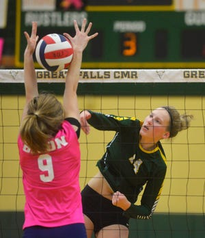 C.M. Russell junior Allie Olsen led the state in kills this past season and is a member of the Tribune's Super-State squad.