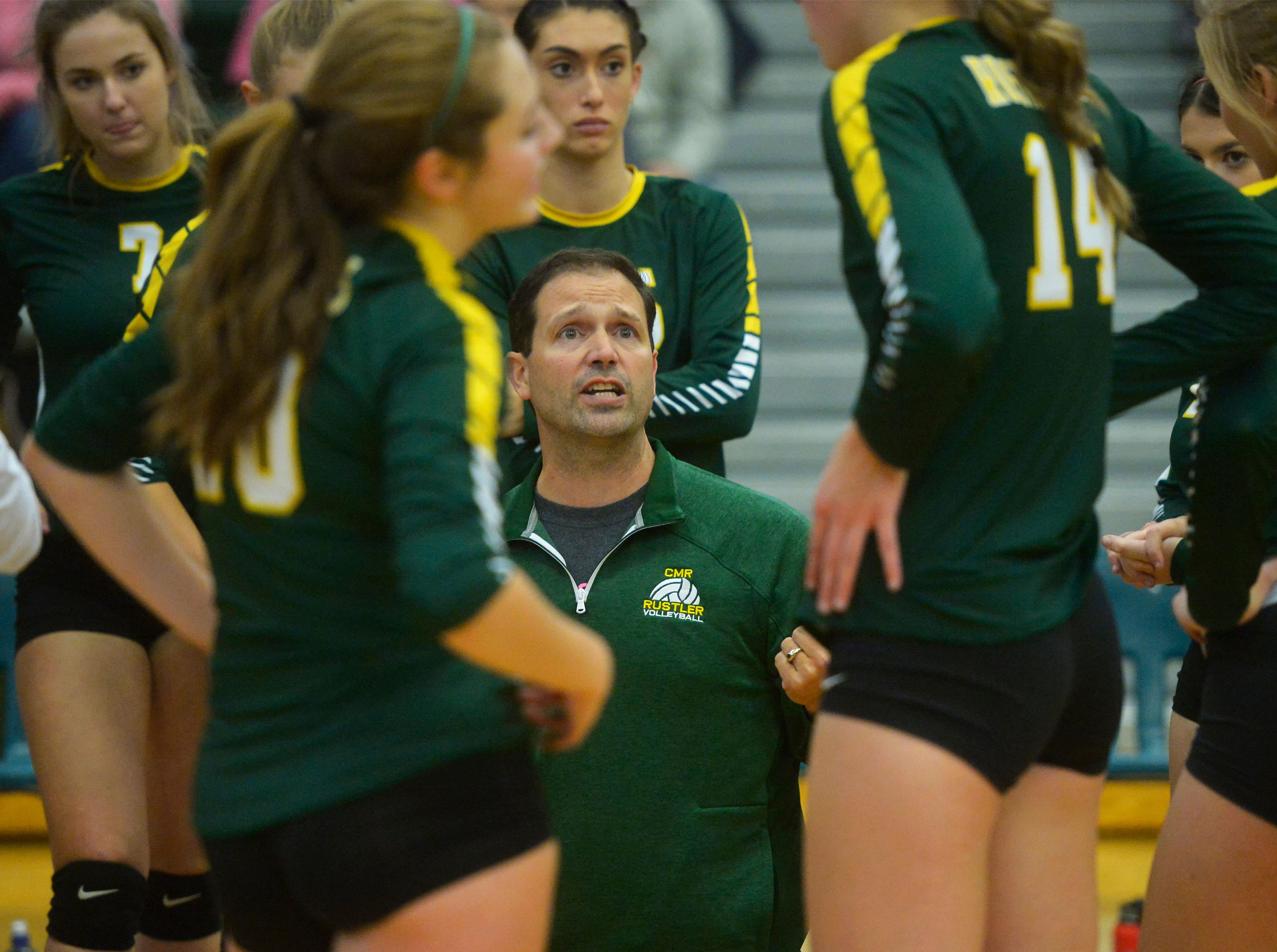 CMR coach Patrick Hiller talks with his team in a timeout during the crosstown volleyball match in the CMR Fieldhouse, Tuesday.