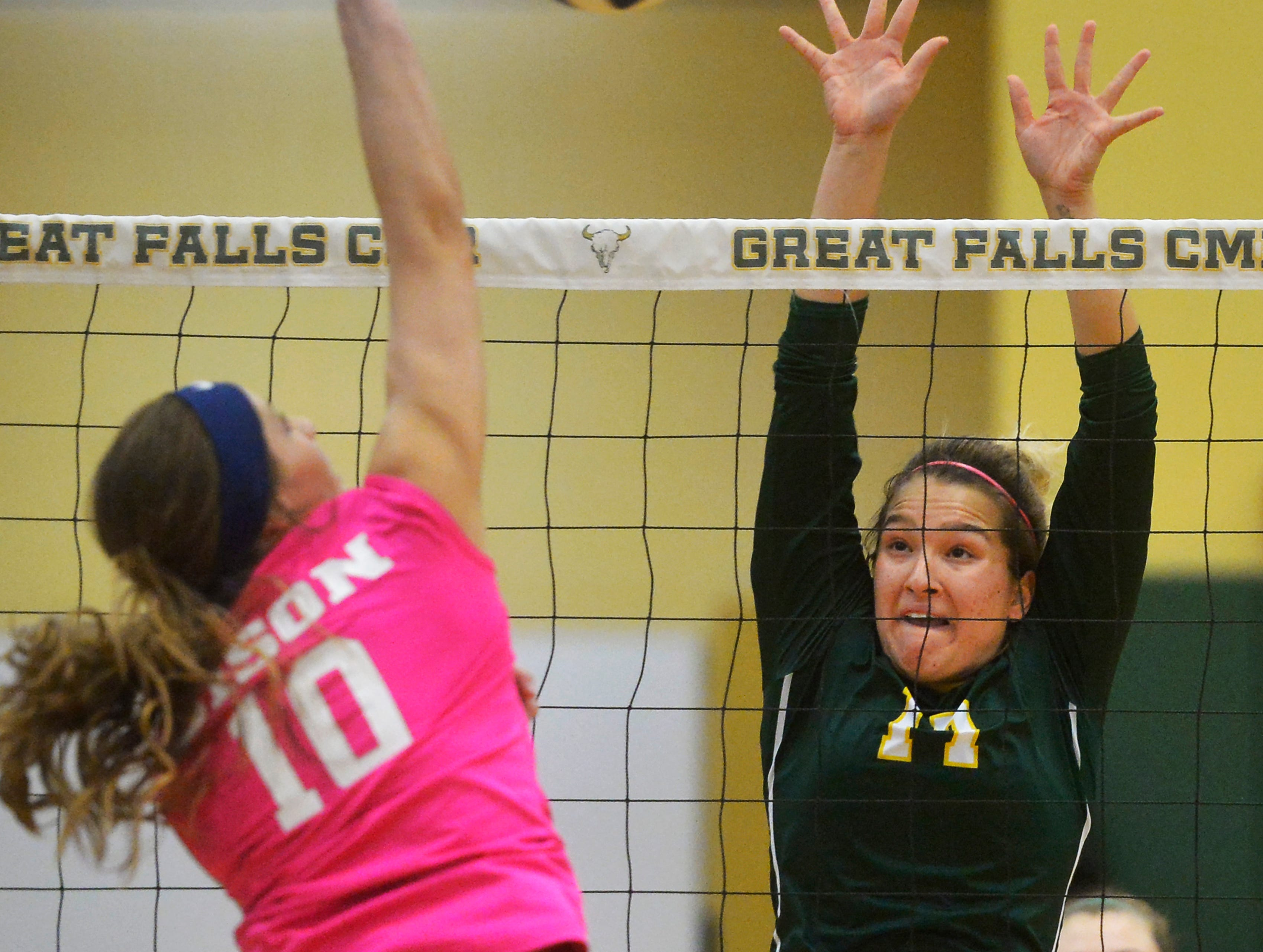 CMR's #17 defends the net during the Crosstown volleyball match in the CMR Fieldhouse, Tuesday.