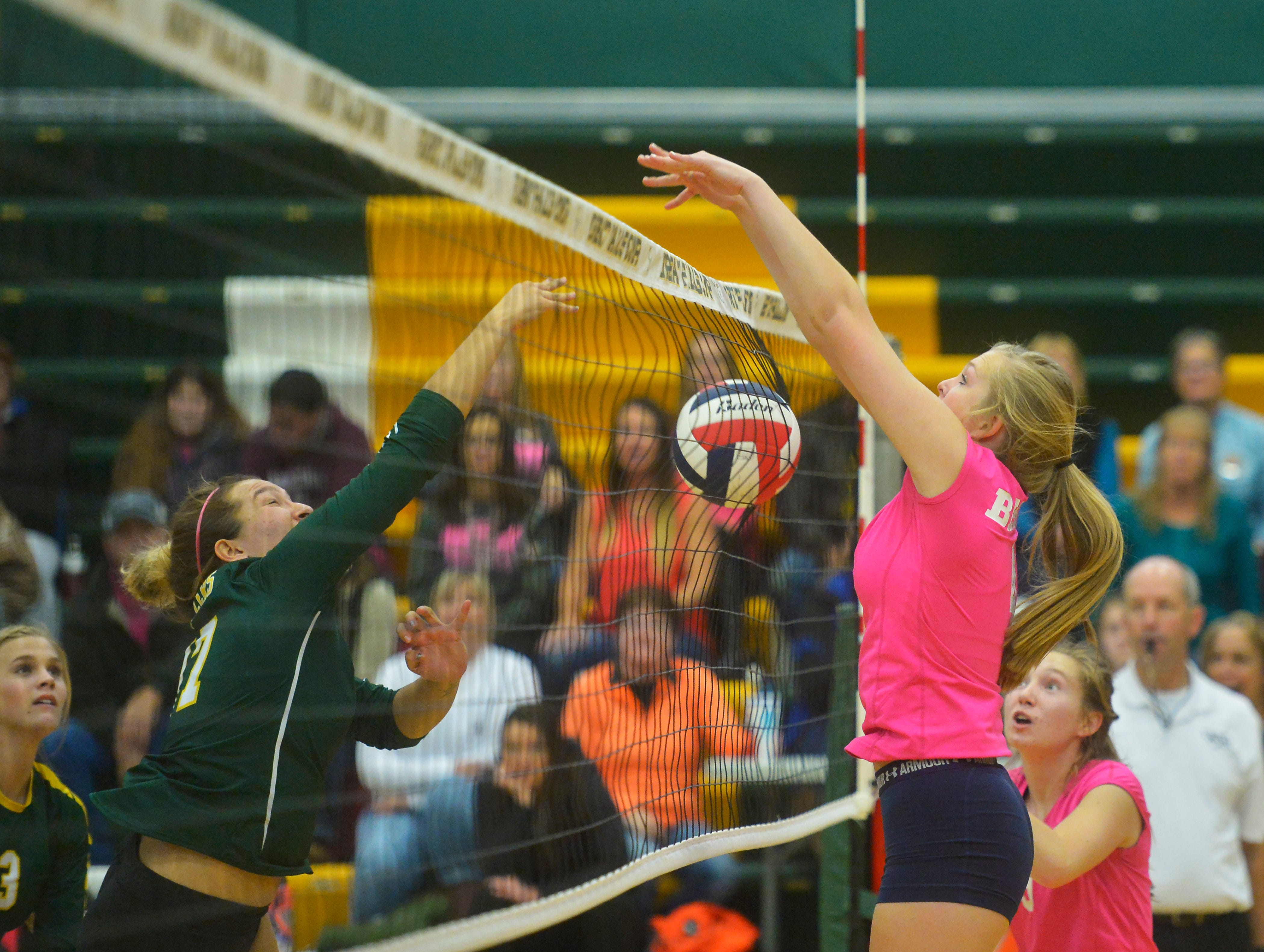 Great Falls High's Abbie Goskreutz defends the net during the crosstown volleyball match in the CMR Fieldhouse, Tuesday.