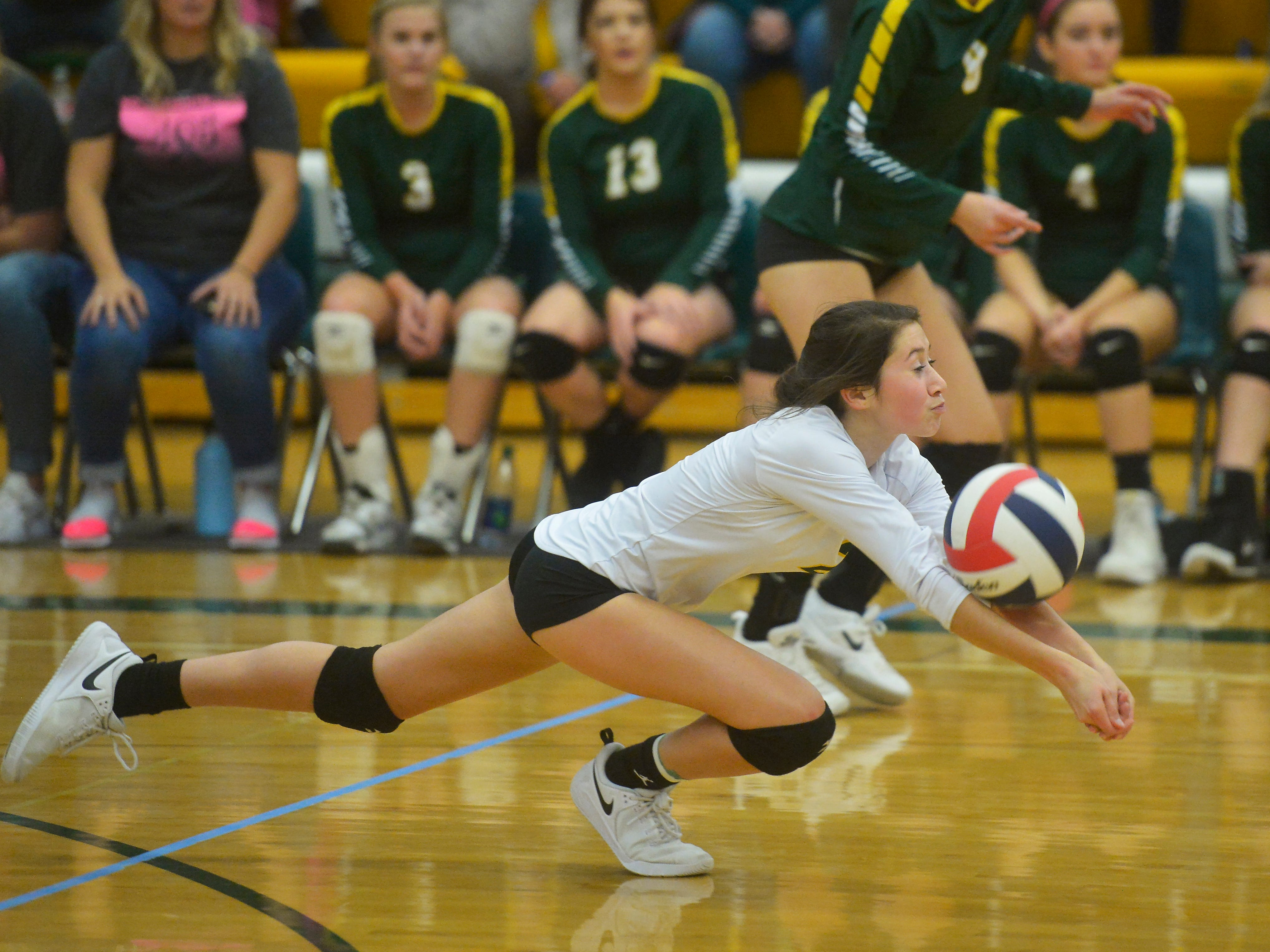 CMR's Lauren Lindseth saves a point during the crosstown volleyball match in the CMR Fieldhouse, Tuesday.