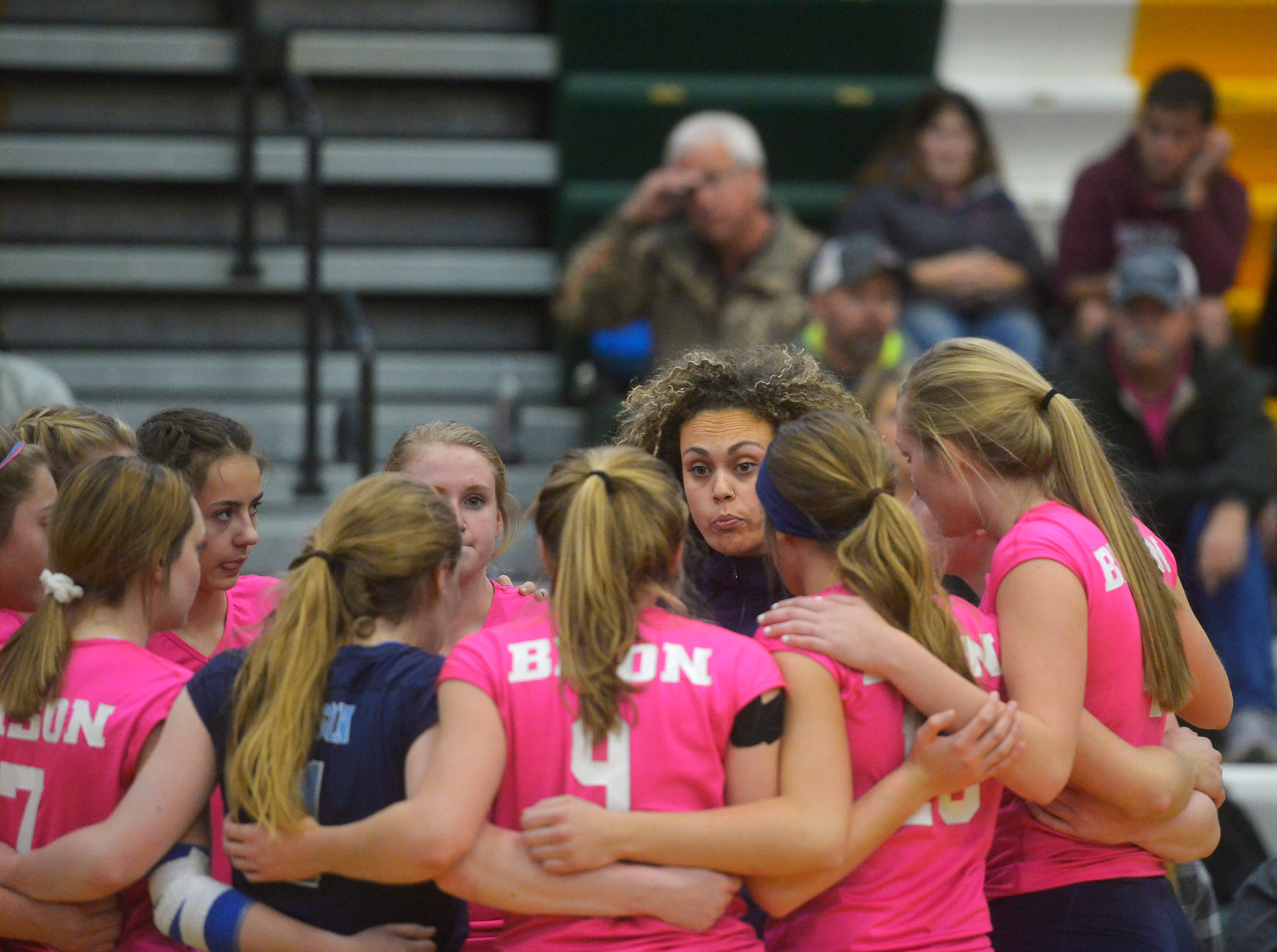 Great Falls High coach Alissa Blevins huddles with her team during the crosstown volleyball match in the CMR Fieldhouse, Tuesday.