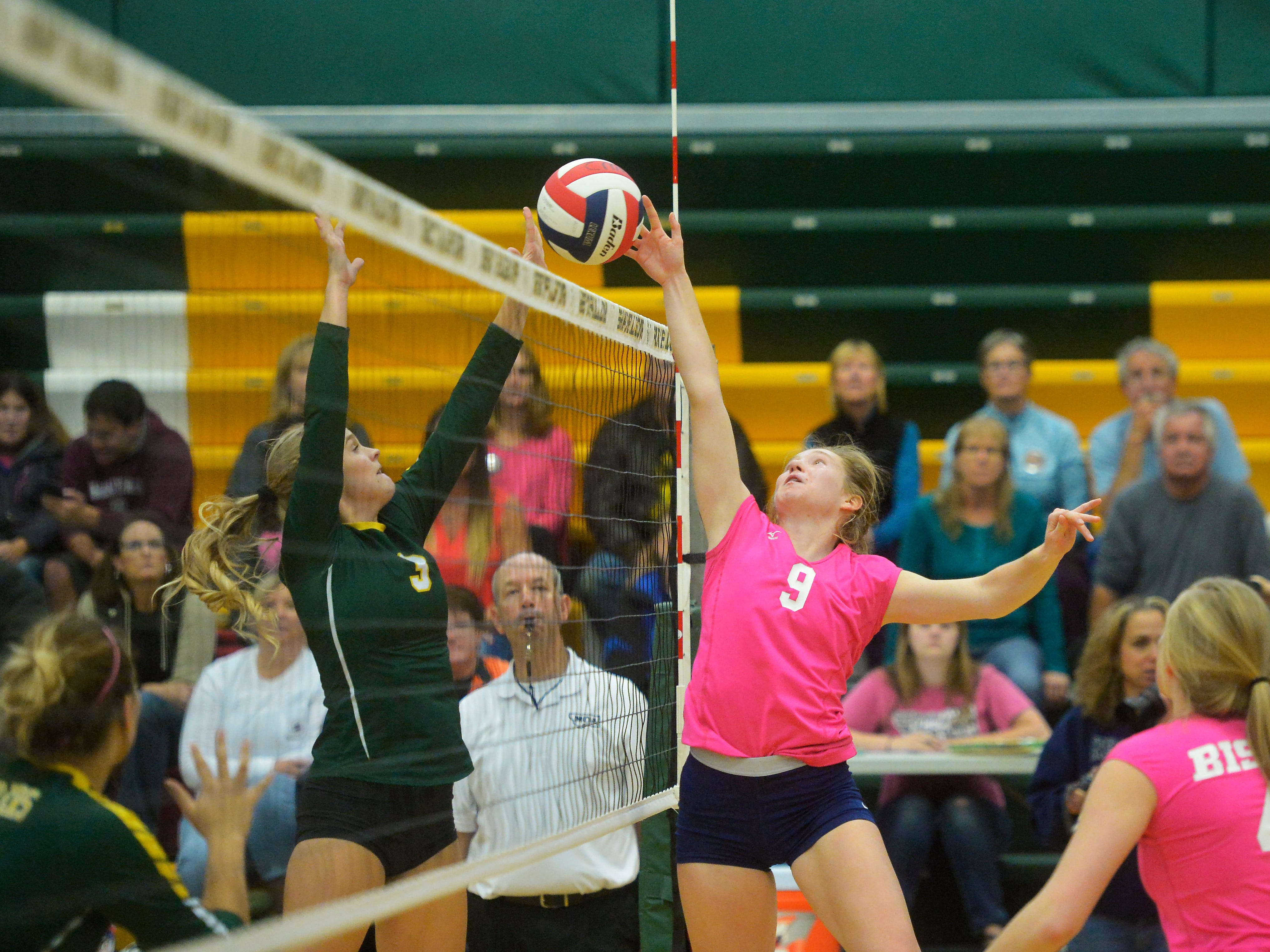 CMR's Teagan Taylor, left, and Great Falls High's Melena Bruskotter battle at the net during the crosstown volleyball match in the CMR Fieldhouse, Tuesday.