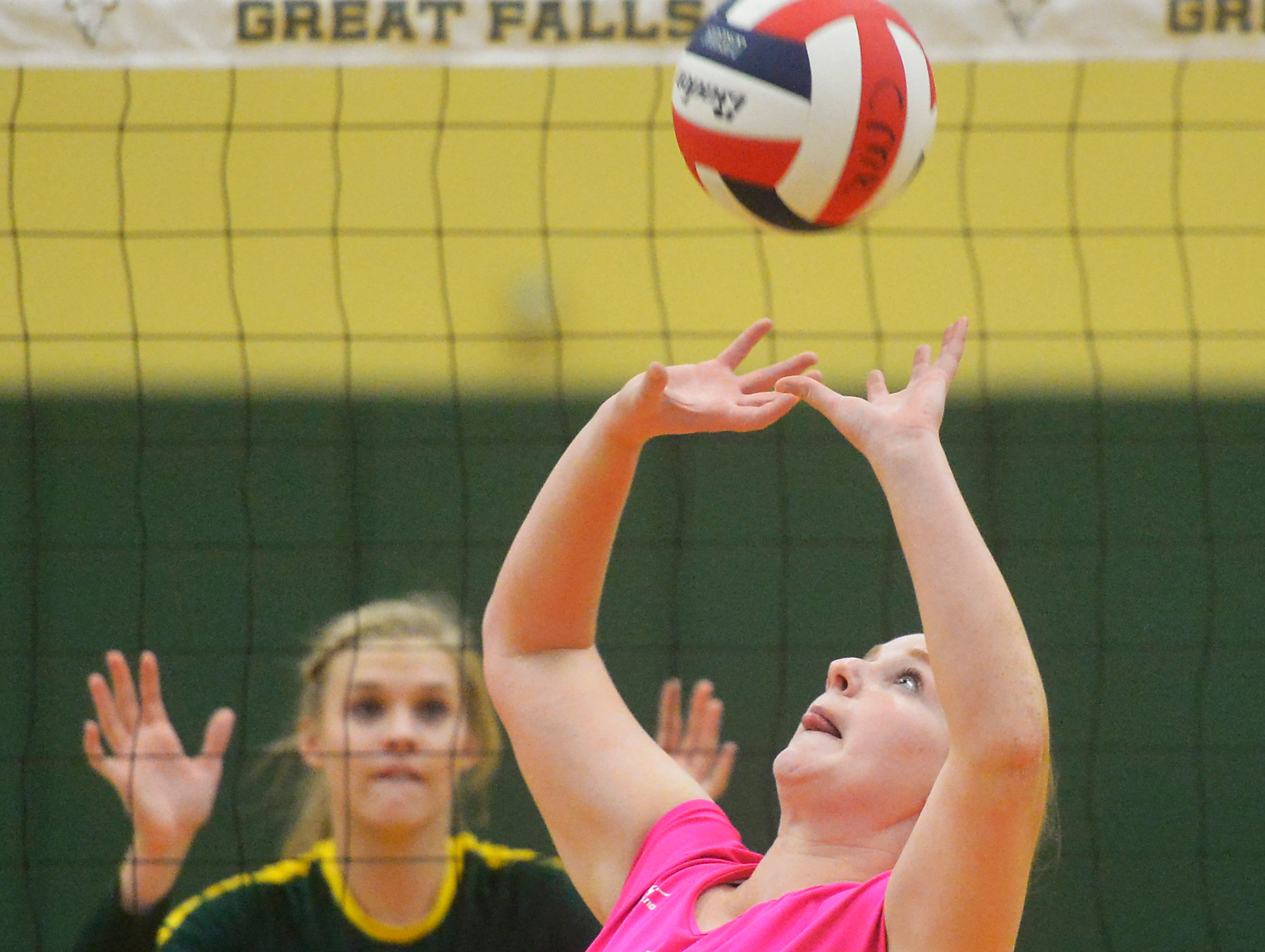 Great Falls High's Celia Keil sets for a teammate during the Crosstown volleyball match in the CMR Fieldhouse, Tuesday.