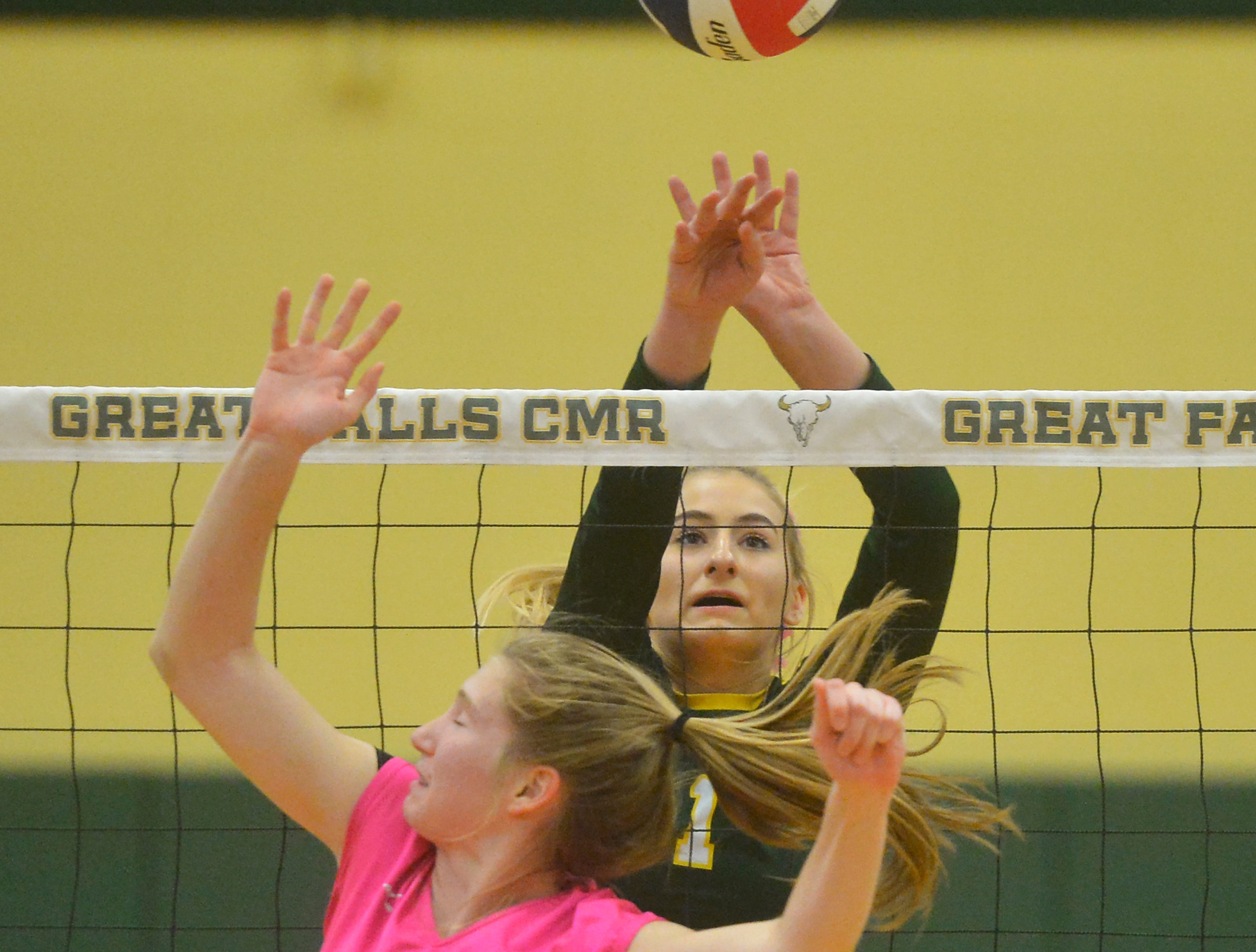 CMR's Maddie Mohler defends the net during the Crosstown volleyball match in the CMR Fieldhouse, Tuesday.