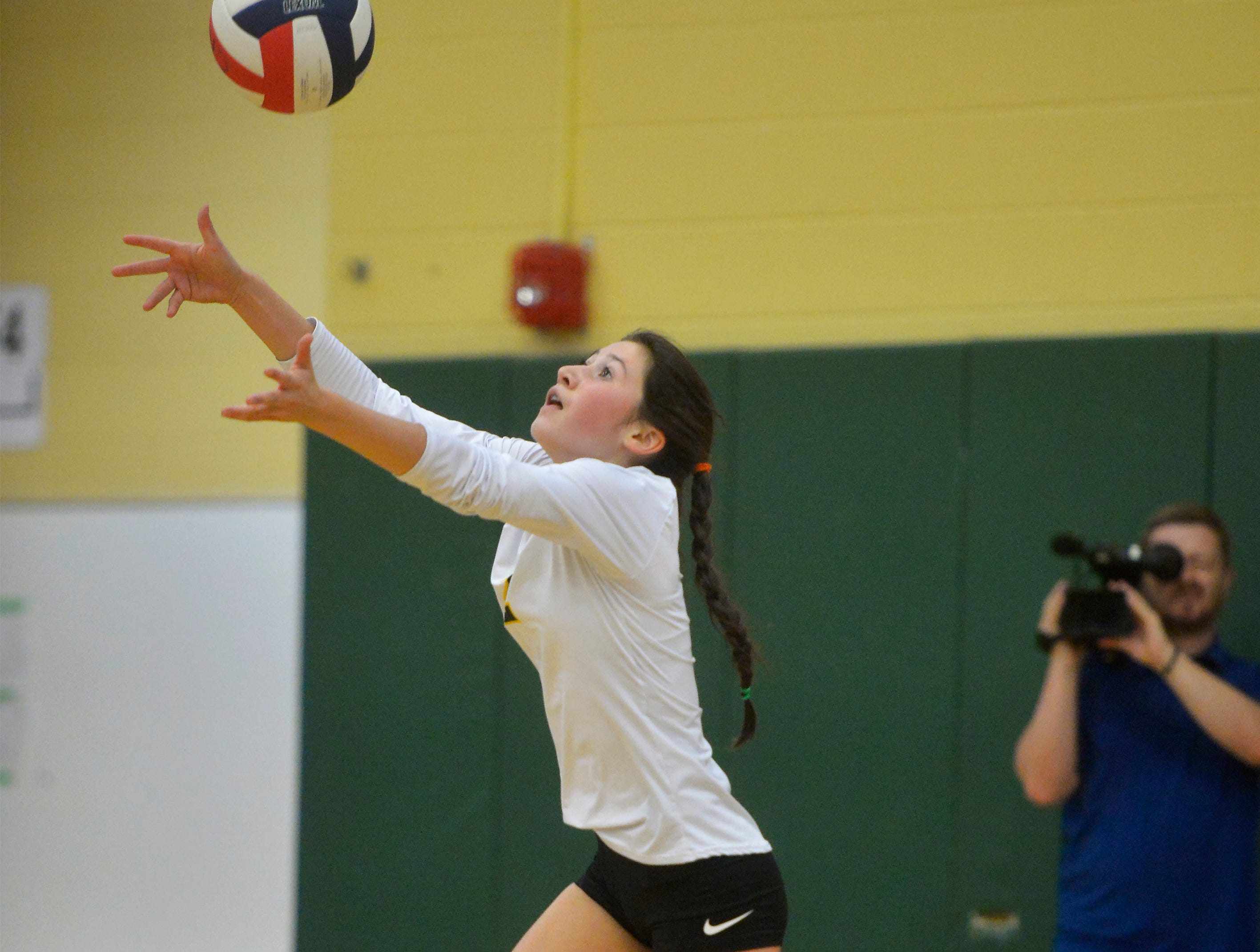 CMR's Lauren Lindseth serves during the crosstown volleyball match in the CMR Fieldhouse, Tuesday.