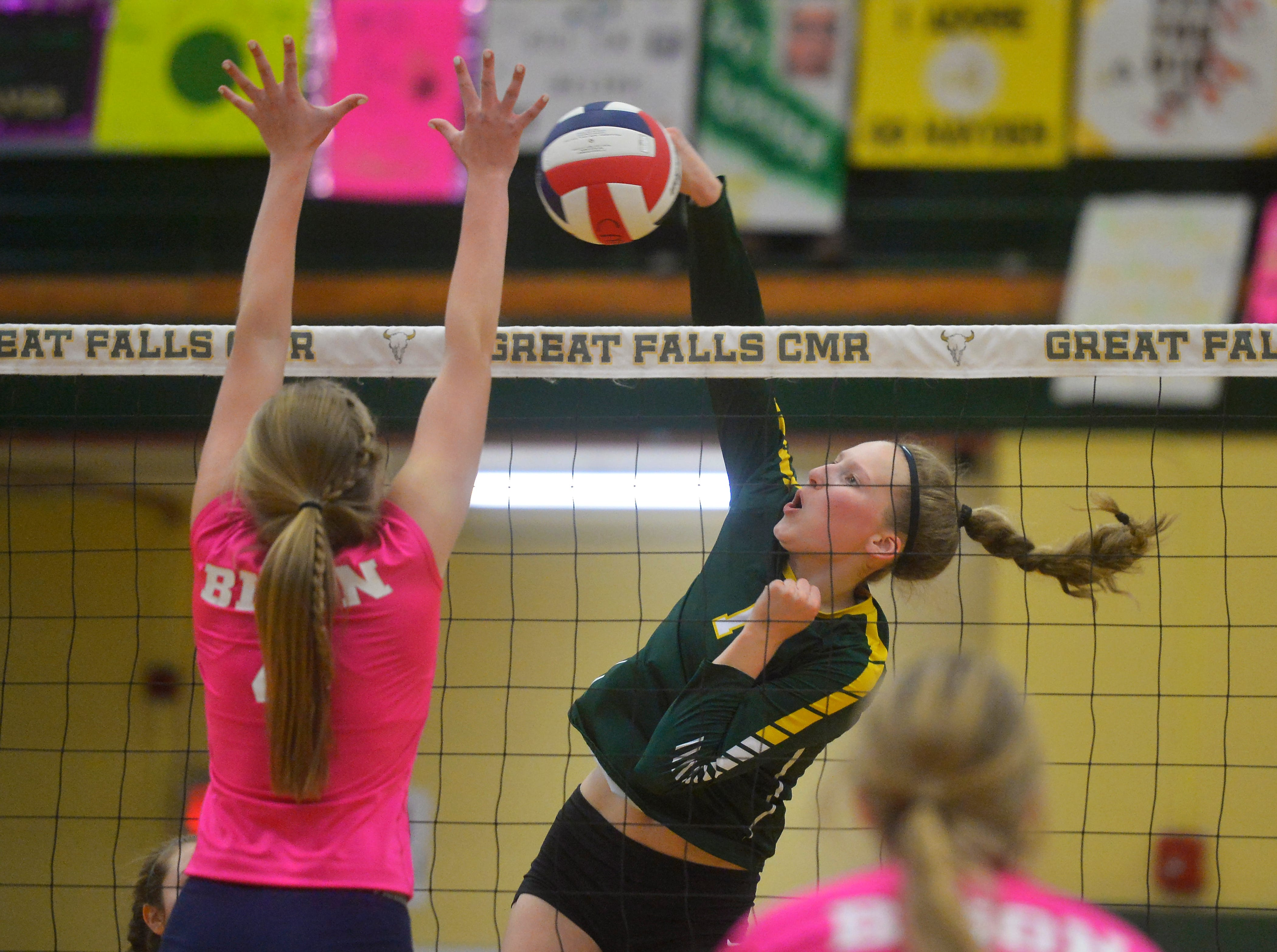 CMR's Allie Olsen spikes against Great Falls High's Abbie Groskreutz during the crosstown volleyball match in the CMR Fieldhouse, Tuesday.