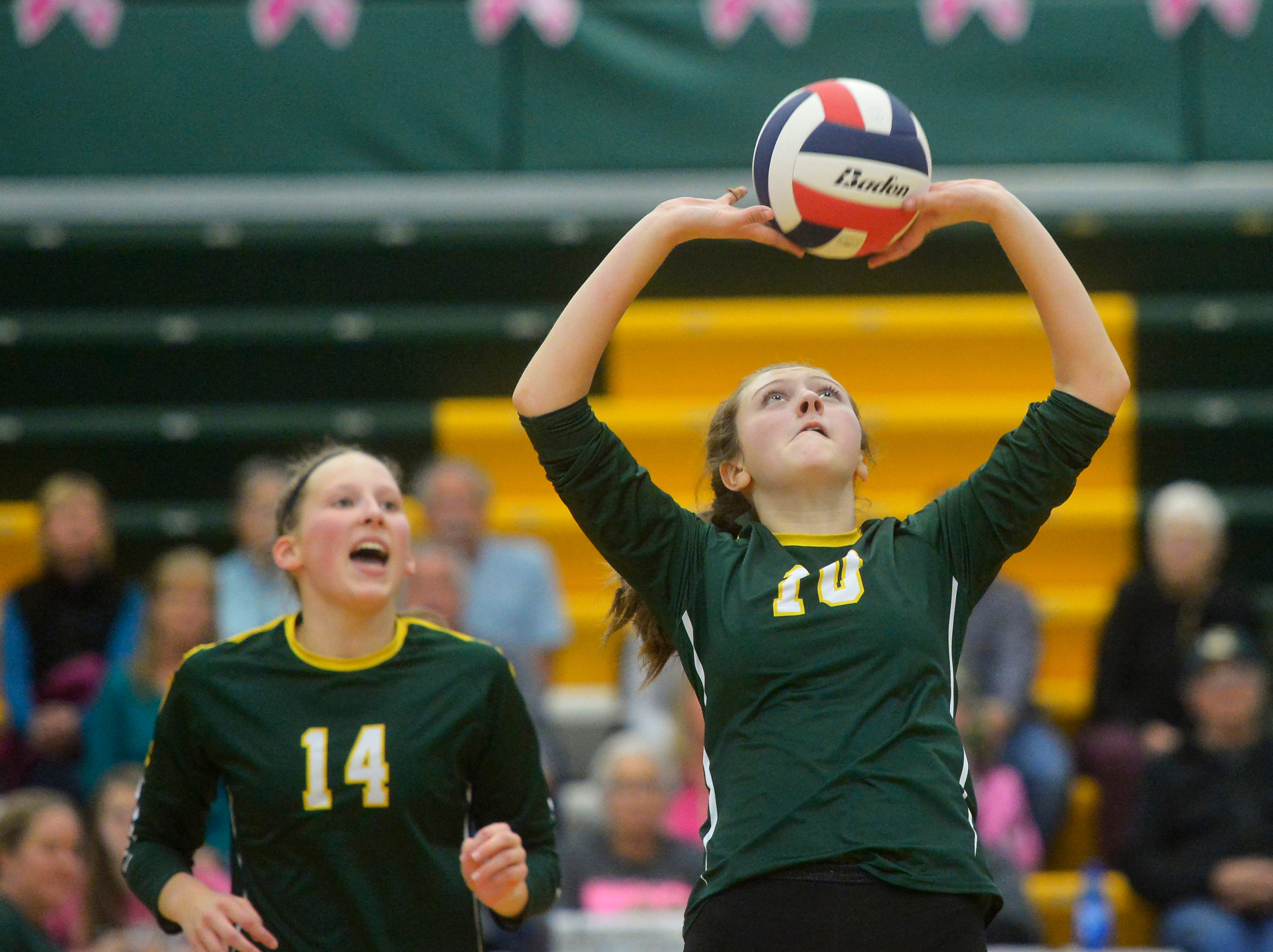 CMR's Tennisen Hiller sets for a teammate during the crosstown volleyball match in the CMR Fieldhouse, Tuesday.