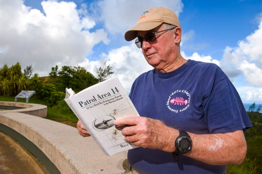 Guam historian and local author, Dave Lotz, thumbs through his latest book, Patrol Area 14, during a visit to the War In The Pacific National Historical Park - Asan Bay Overlook on Nimitz Hill on Tuesday, Oct 9, 2018.