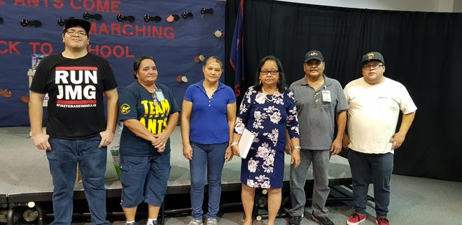 Ordot-Chalan Pago Elementary School recognizes Victoria Guerrero (fourth from left) for her 24 years of service with the Guam Department of Education. Pictured is Guerrero and cafeteria staff.