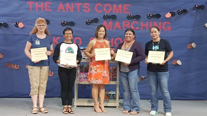 """Ordot-Chalan Pago Elementary School commends ongoing community partners. From the left: Joaline Smith on behalf of Mark Smith, Rosie Howser on behalf of Burnham """"JR"""" Howser, Trisia Mafnas, Myra Jean Aguon and Sheila Paulino with 'Anything and Everything Thrift Store.'"""