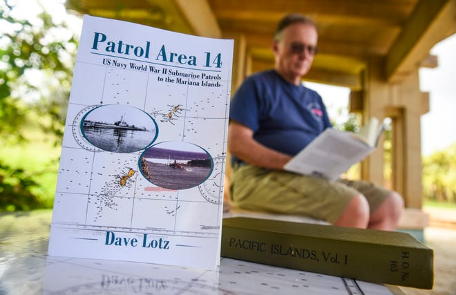 Guam historian and local author, Dave Lotz, looks through a copy of his latest book, Patrol Area 14, during a visit to the War In The Pacific National Historical Park - Asan Bay Overlook on Nimitz Hill on Tuesday, Oct 9, 2018.