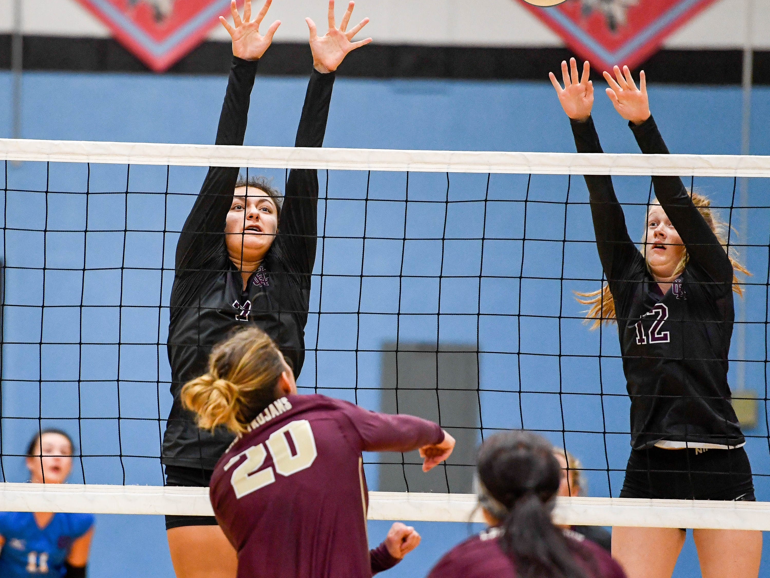 Henderson's Kaylee Stott (7) and  Macala Walker (12) try to block a shot from Webster's Lana Eastwood (20) as the Henderson County Lady Colonels play the Webster County Lady Trojans in the District Volleyball Tournament championship match in Morganfield, Tuesday, October 9, 2018.