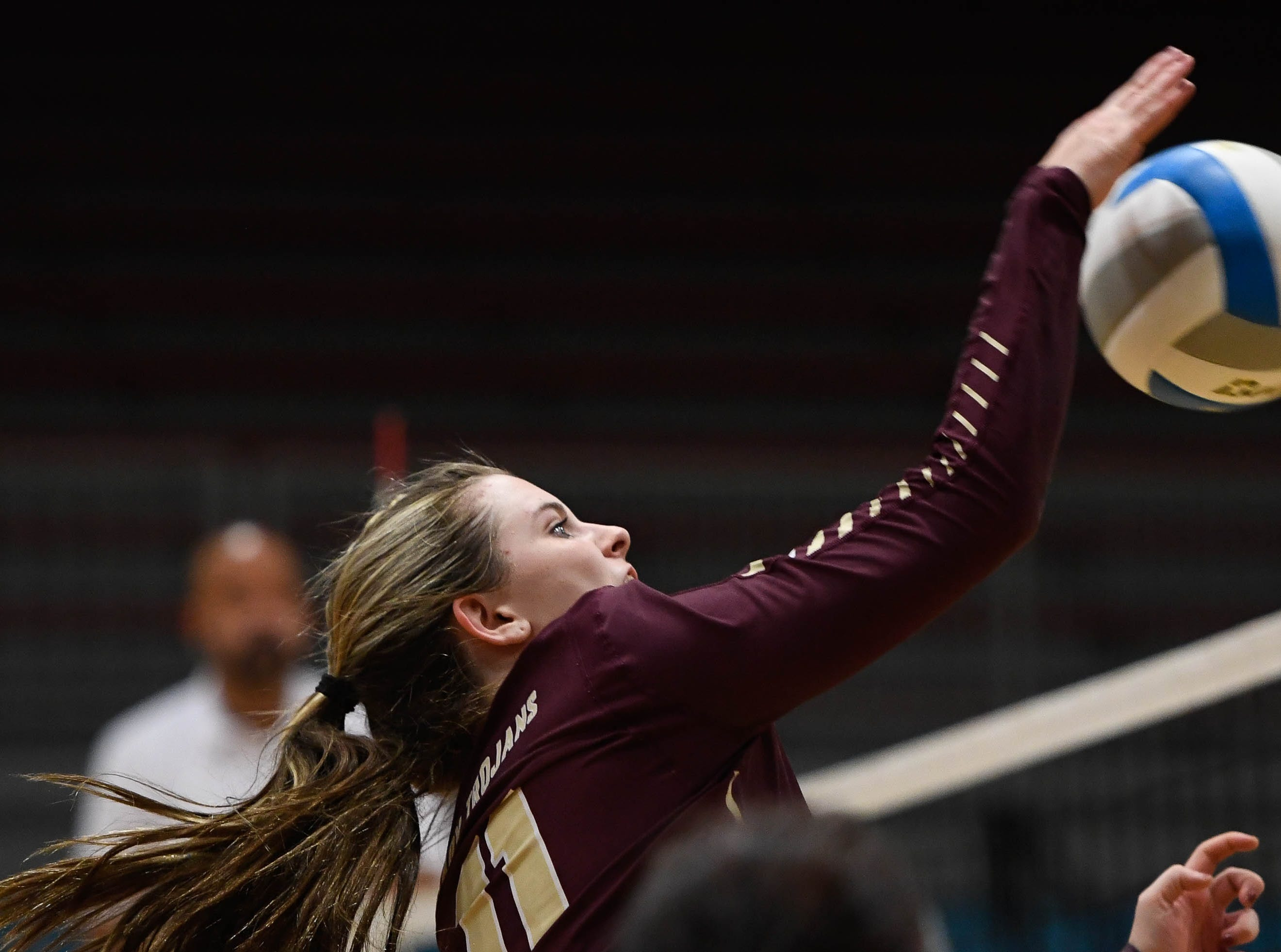 Webster's Maggie Jones (11) plays at the net as the Henderson County Lady Colonels play the Webster County Lady Trojans in the District Volleyball Tournament championship match in Morganfield, Tuesday, October 9, 2018.