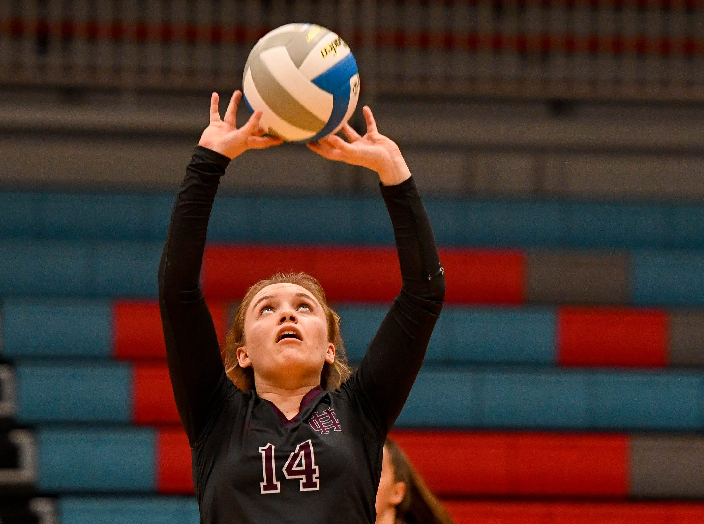Henderson's Kaylee Norman (14) sets the ball as the Henderson County Lady Colonels play the Webster County Lady Trojans in the District Volleyball Tournament championship match in Morganfield, Tuesday, October 9, 2018.
