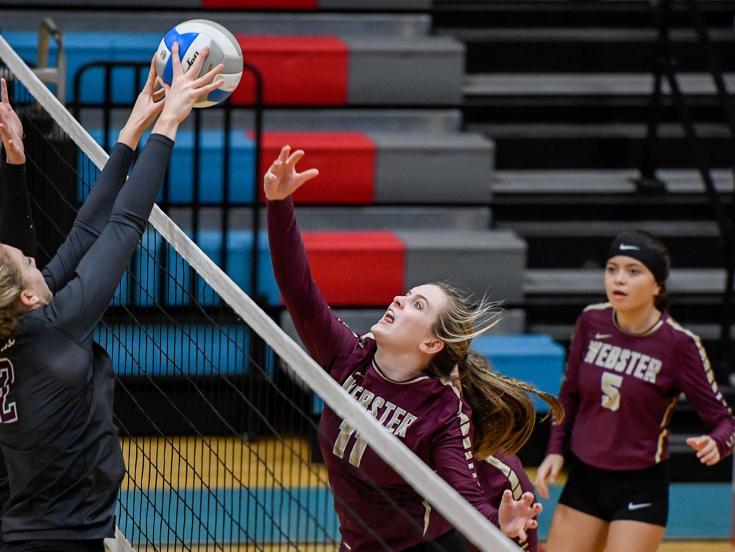 Henderson's Brooke Springer (2) blocks a shot from Webster's Maggie Jones (11) as the Henderson County Lady Colonels play the Webster County Lady Trojans in the District Volleyball Tournament championship match in Morganfield, Tuesday, October 9, 2018.