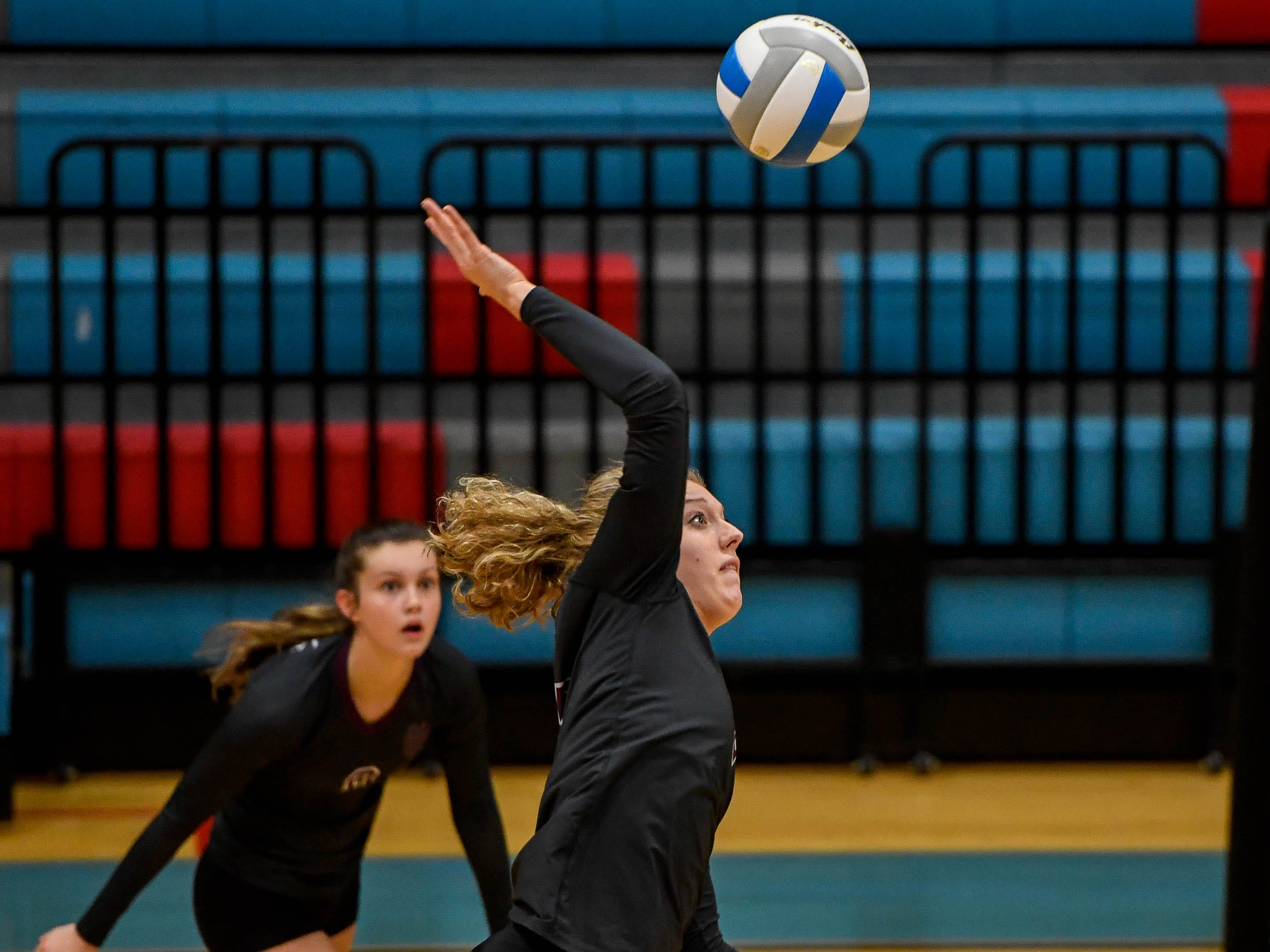 Henderson's Brooke Springer (2) attacks as the Henderson County Lady Colonels play the Webster County Lady Trojans in the District Volleyball Tournament championship match in Morganfield, Tuesday, October 9, 2018.