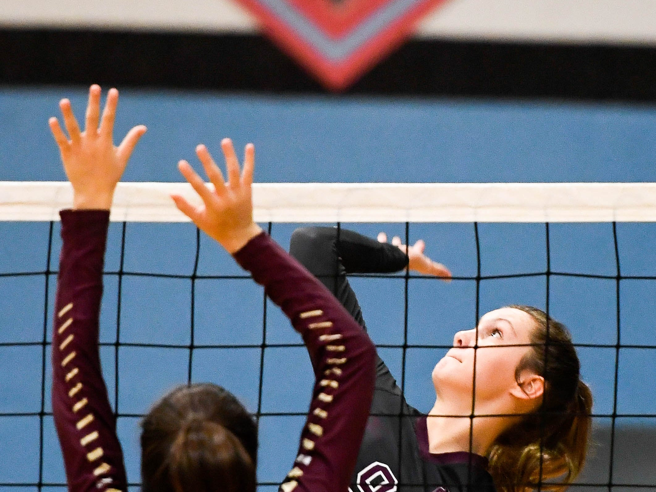 Henderson's Jordan Troutman (9) and Webster's Adrianna Lopez (5) battle at the net as the Henderson County Lady Colonels play the Webster County Lady Trojans in the District Volleyball Tournament championship match in Morganfield, Tuesday, October 9, 2018.