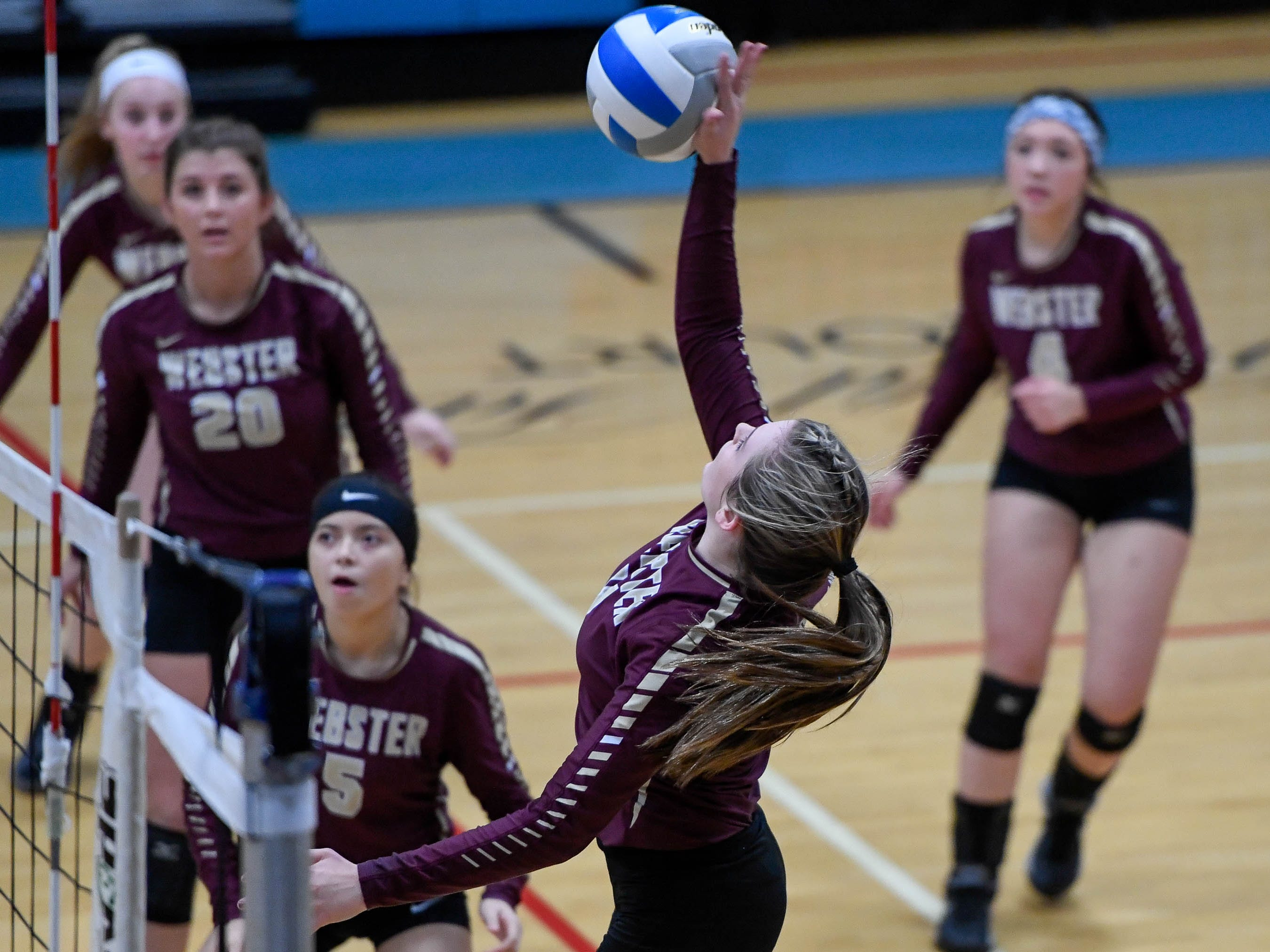 Webster's Maggie Jones (11) attacks as the Henderson County Lady Colonels play the Webster County Lady Trojans in the District Volleyball Tournament championship match in Morganfield, Tuesday, October 9, 2018.