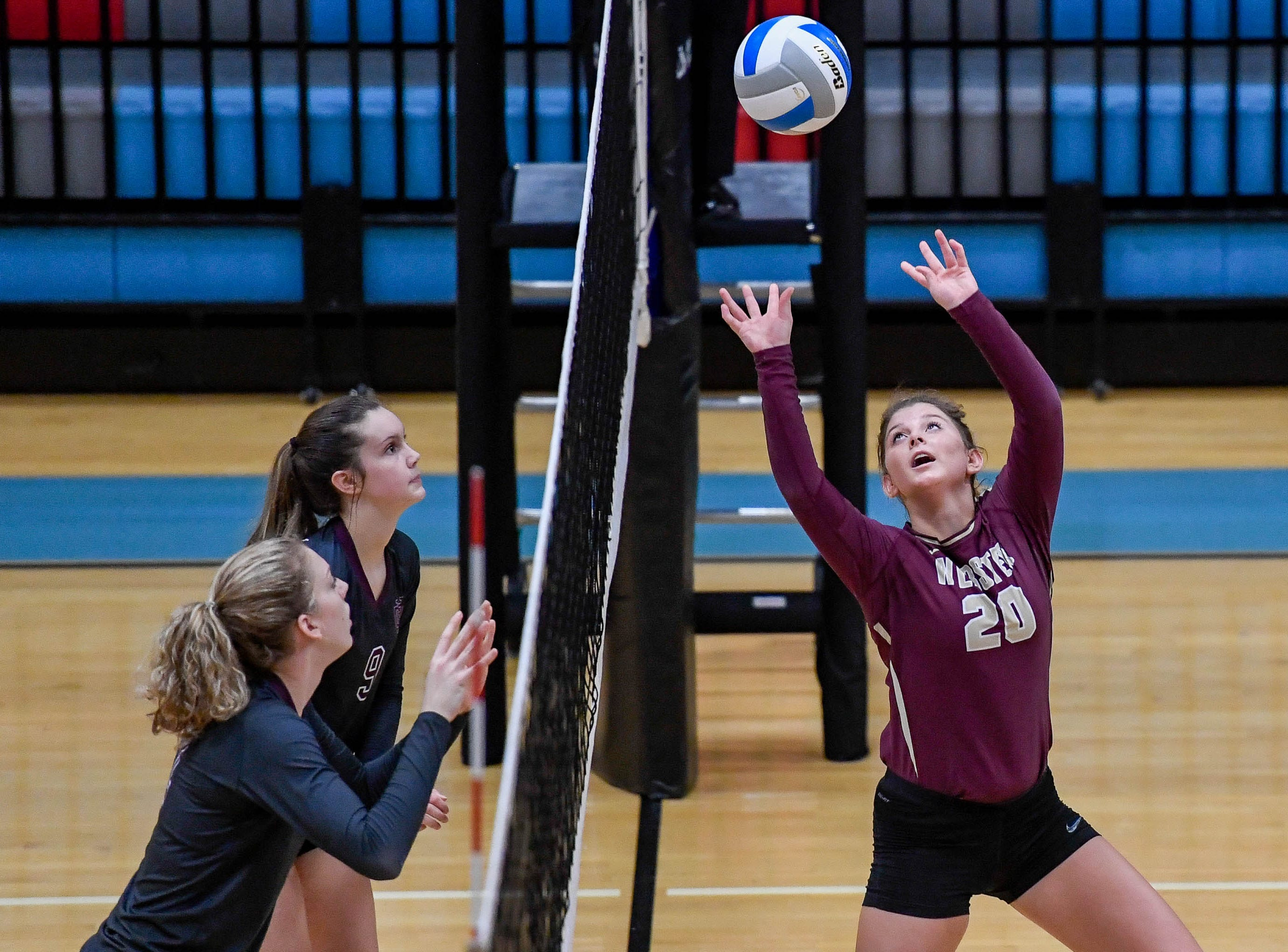 Webster's Lana Eastwood (20) plays at the net as the Henderson County Lady Colonels play the Webster County Lady Trojans in the District Volleyball Tournament championship match in Morganfield, Tuesday, October 9, 2018.