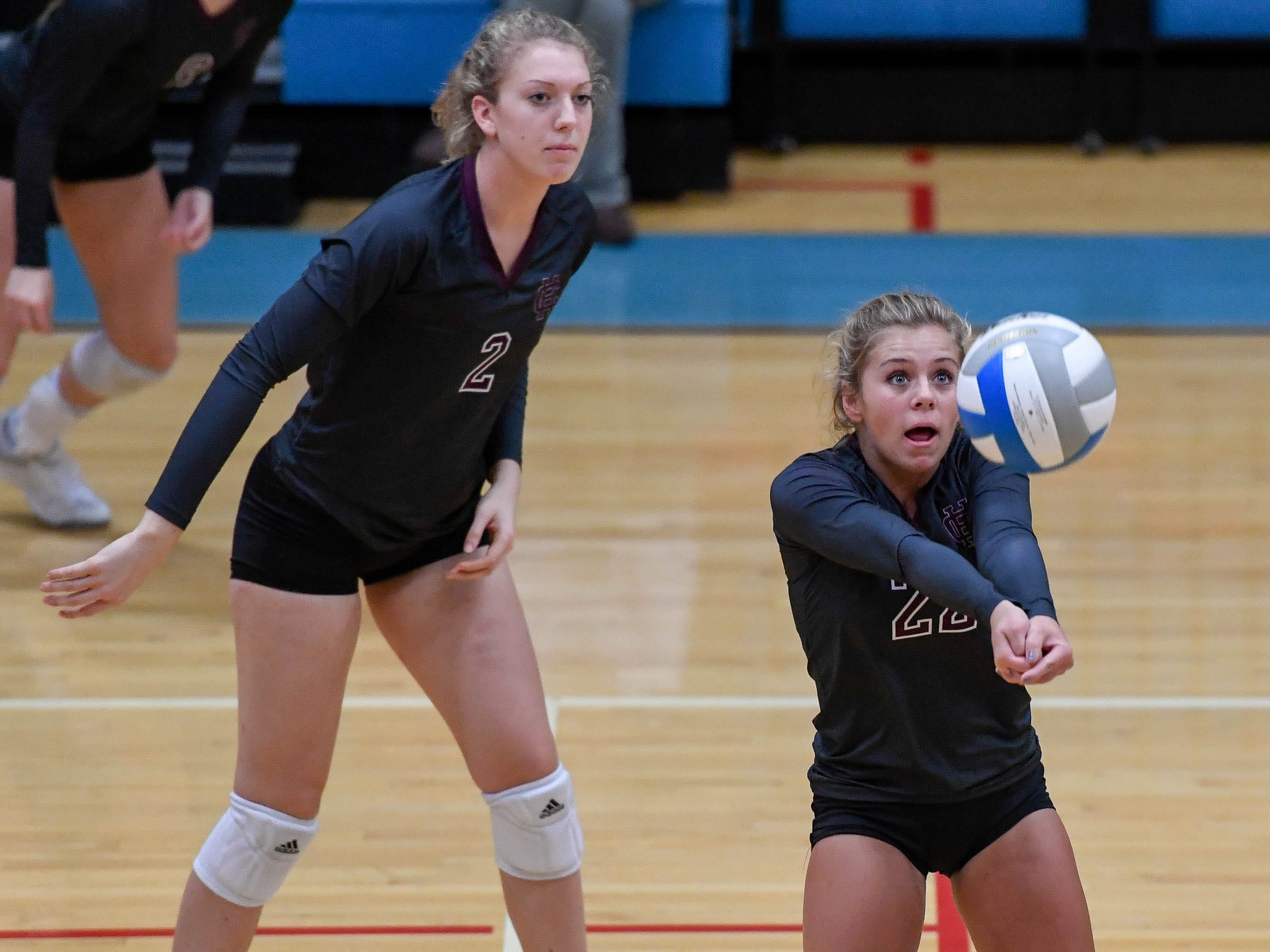 Henderson's Avery Marshall (22) sets the ball as the Henderson County Lady Colonels play the Webster County Lady Trojans in the District Volleyball Tournament championship match in Morganfield, Tuesday, October 9, 2018.