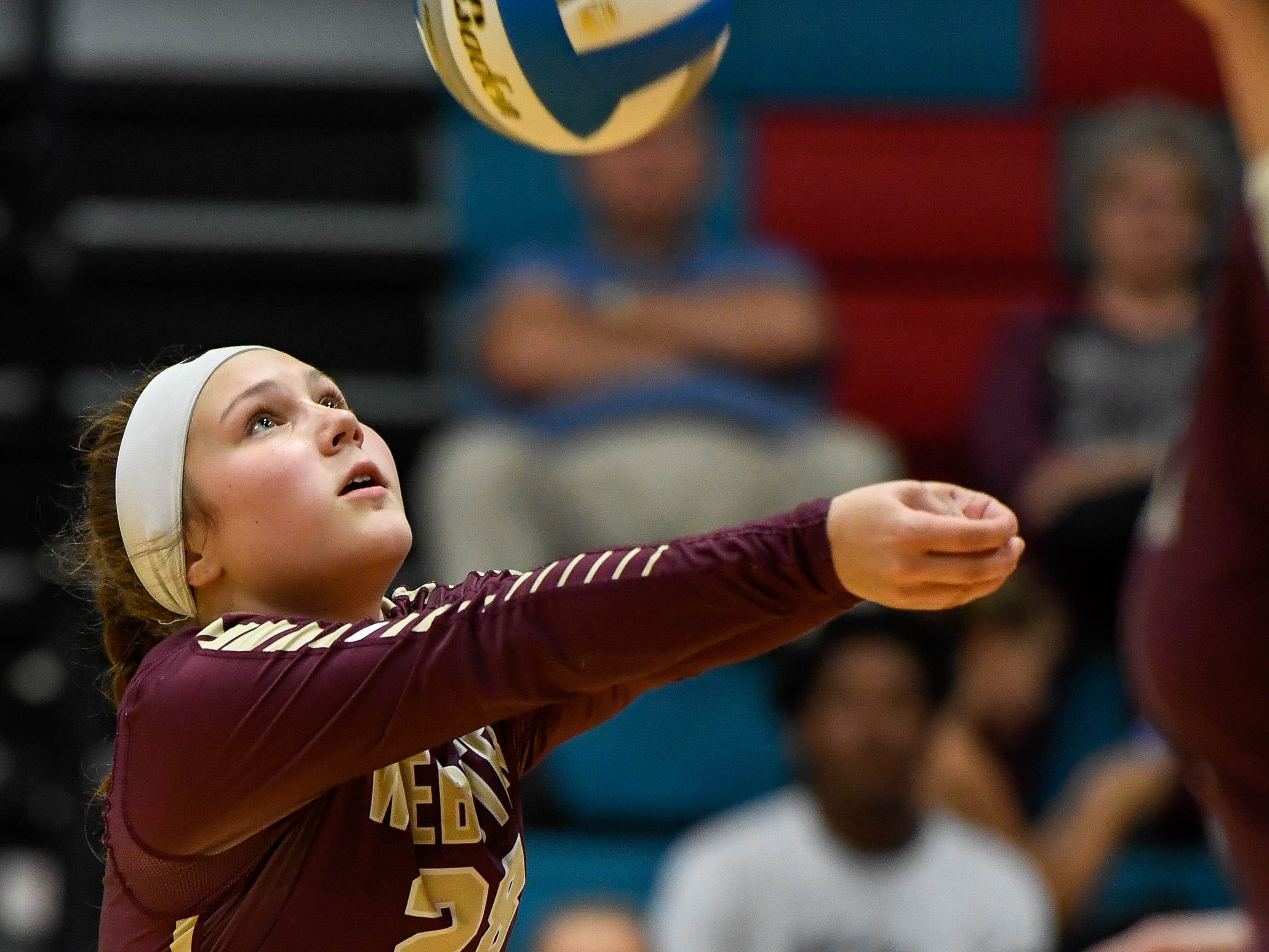 Webster's Audrie Ellis (28) sets the ball up for a teammate as the Webster County Lady Trojans play the Union County Bravettes in the District Volleyball Tournament in Morganfield, Tuesday, October 9, 2018.