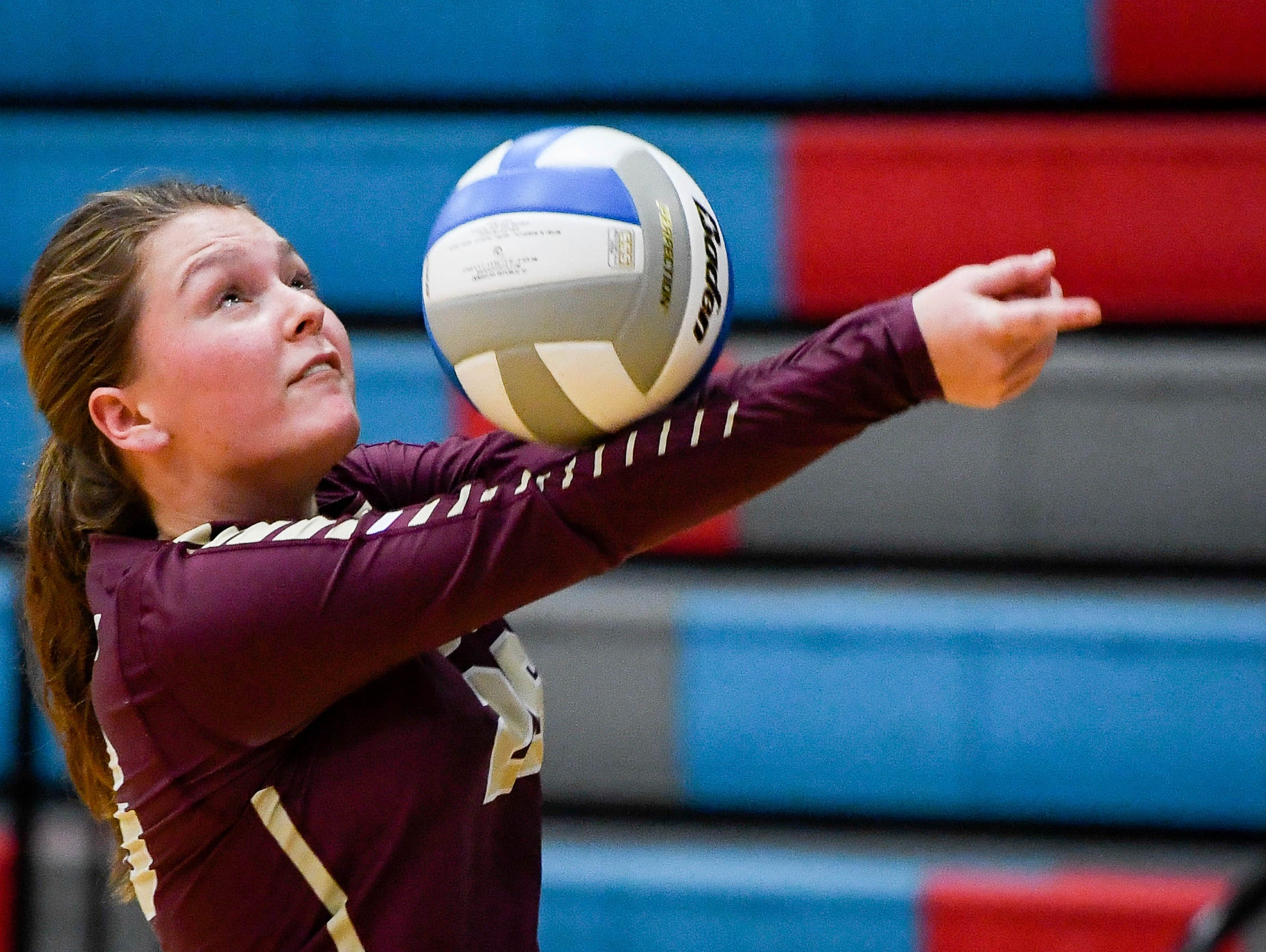 Webster's Julie Eastwood (26) sets the ball as the Henderson County Lady Colonels play the Webster County Lady Trojans in the District Volleyball Tournament championship match in Morganfield, Tuesday, October 9, 2018.