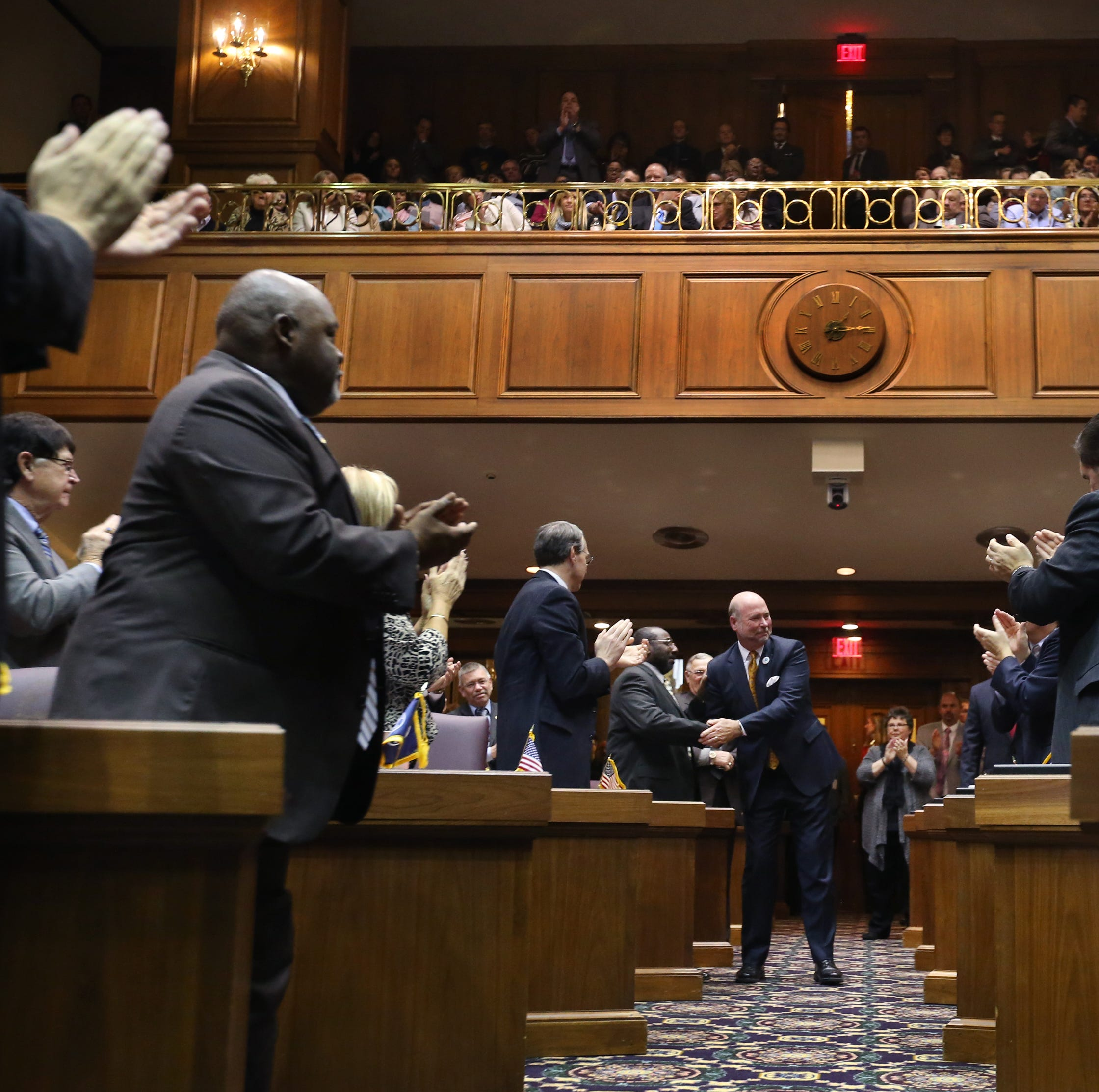 Speaker of the House Brian Bosma, R-Indianapolis, heads up the center aisle of the House shaking hands shakes hands at the beginning of Organization Day for the 119th Indiana General Assembly at the Indiana Statehouse in Indianapolis on Tuesday, Nov. 18, 2014.