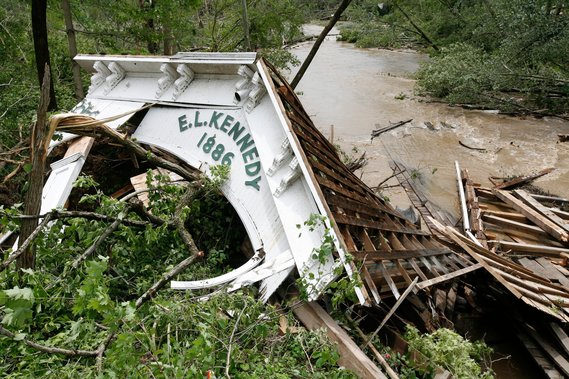 The remains of the Moscow covered bridge stretch across the water June 4, 2008, after the historic landmark was destroyed by an overnight tornado in the small Rush County town. It was rebuilt in 2010.
