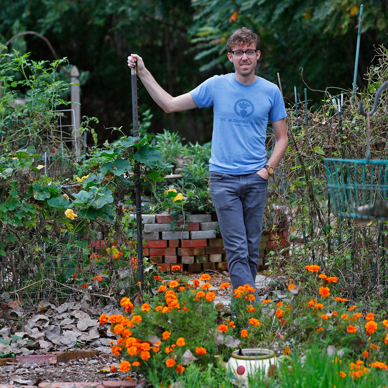 Andrew Fritz stands in the Gleaning Garden in...