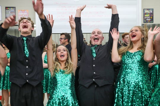Second from right, Austin Hewitt and other senior students throw their hands in the air after circling for a pep chant and prayer before Eastern High School's fall show choir concert in Greentown, Ind., Wednesday, Sept. 26, 2018. In June 2017, Hewitt was declared free of the Ewing sarcoma cancer that led to his toe being amputated. One year later, Ewitt learned the cancer was back in his leg and will soon undergo amputation below the knee.