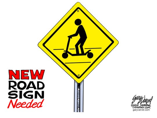 Cartoonist Gary Varvel's take on scooters: Indianapolis needs these new road signs.