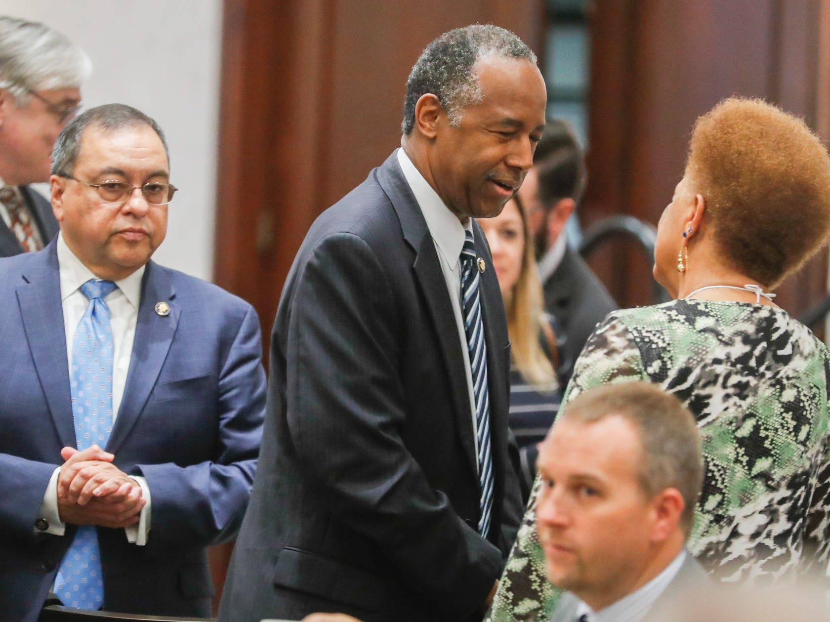 HUD Secretary Ben Carson, center, mixes and mingles before giving the Keynote speech during the Indiana Civil Rights CommissionÕs Fair Housing Law and Policy Conference, held at the     Sheraton Indianapolis City Centre Hotel on Wednesday, Oct. 10, 2018.