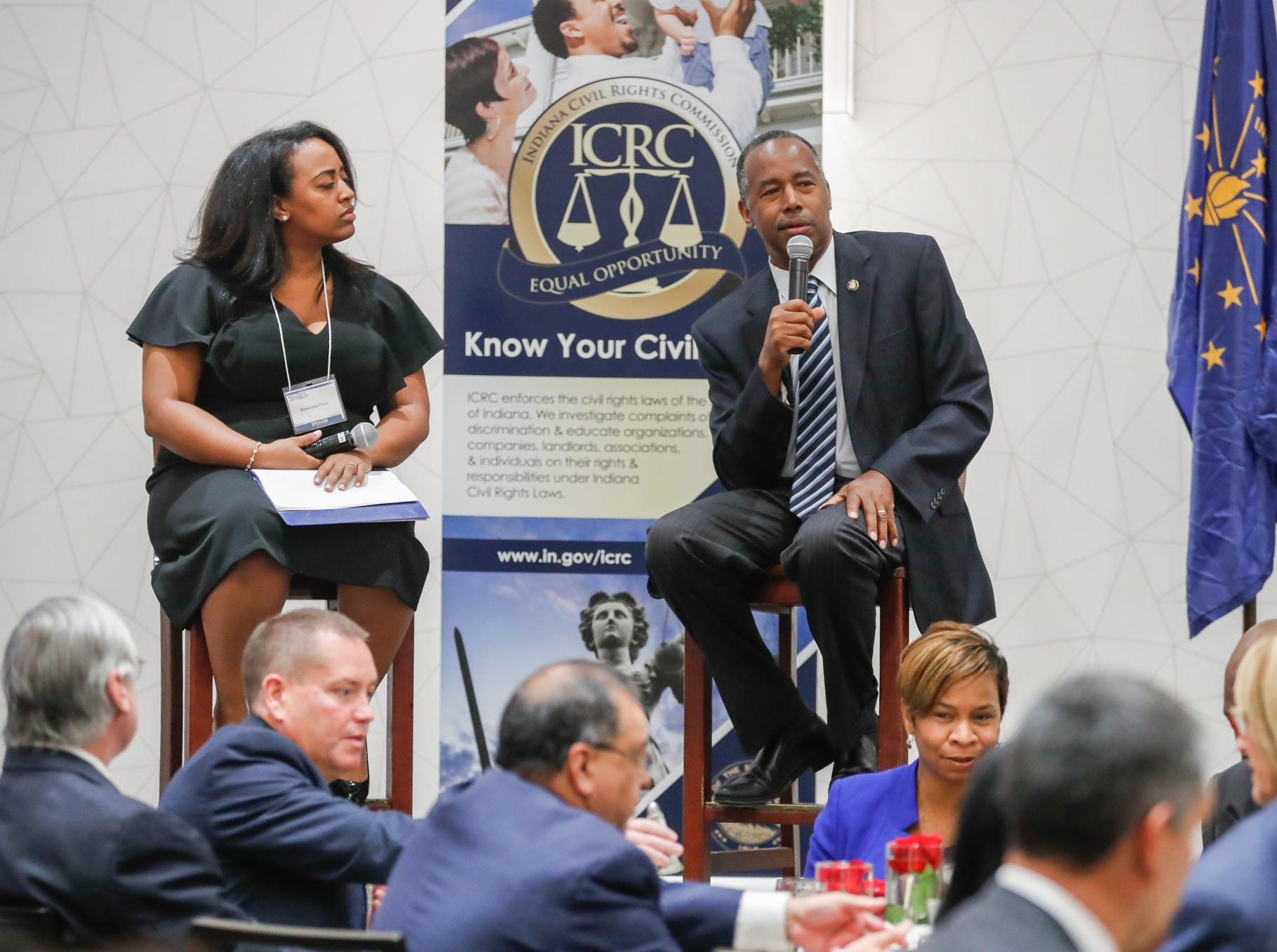 Deputy Director and General Council for the Indiana Civil Rights Commission, Doneisha Posey, left, and HUD Secretary Ben Carson, right, takes submitted questions after Carson's Keynote speech during the Indiana Civil Rights Commission's Fair Housing Law and Policy Conference, held at the     Sheraton Indianapolis City Centre Hotel on Wednesday, Oct. 10, 2018.
